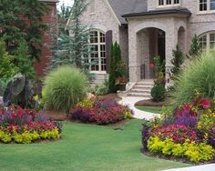 Minimalist style of front yard landscape design  Or not minimalist.  lots of flower filled shapes