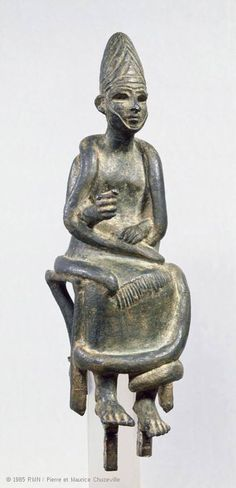 Bronze figurines are found in most Bronze Age urban sites in the Near East, especially those on the Levant coast. This statuette, one of the finest examples of seated gods from this period, was purchased in the Homs region of Syria. It probably came from the city of Katna, which maintained a flourishing trade with the coast.