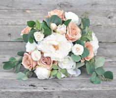 """Romantic, soft faux flower wedding bouquet to last a lifetime!  Keepsake flower bouquet made with dusty pink roses, ivory peonies, eucalyptus and baby roses.  It measures approximately 12"""" in diameter by 13"""" tall and ribbon requests are welcome.  Faux bouquets insure you will have the exact color choice for your flowers, as well as much lighter to carry on your wedding day.  Custom work is welcome, please message us :) #wedding #weddingflowers #bouquet"""