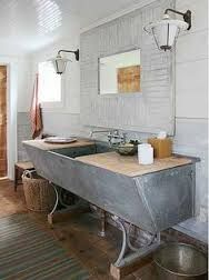 Make your bathroom stand out with a one-of-a-kind vanity. You can put a sink on almost anything! Rescued Cow Trough When New York design firm Carrier and Company converted an old dairy barn into a. Barn Bathroom, Rustic Bathrooms, Bathroom Vanities, Bathroom Ideas, Bathroom Cabinets, Bathroom Designs, Bathroom Modern, Bathroom Inspiration, Bathroom Bath