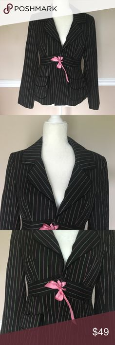 Nanette Lepore Black Striped Ribbon Blazer Size 8 Perfect career blazer to wear with a pencil skirt or slacks! Originally $298. Size 8. Runs small. 34/36inch bust. 24inch sleeve. 5.5inch sleeve opening. 26inch length. Color is black with pink and green pin stripes. Fully lined in Hot Pink. Material is 52% Cotton, 46% Wool, 2% Polyester. Features 2 front faux pockets, Lace up Ribbon closure, black Velvet trim, lightly padded shoulders, and is fully lined. Nanette Lepore Jackets & Coats…