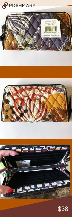 """NWT Vera Bradley Accordion Wallet Just In 🎉 Accordion wallet in Painted Feathers (see matching tote just listed)! Zip around closure, with 2 bill slots, 12 card slots and zipper change compartment. 8"""" L x 4 1/2"""" H. In hues of muted grape, rust, cream, gold, brown and white. MSRP $44 plus tax. Purchase separately or bundle with tote for a discounted price 👍🏻😊 Vera Bradley Bags Wallets"""