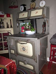 Antique Home Comfort gray granite wood burning cook stove.