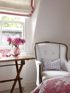 LOVE -Cosy Bedroom Nook -Accent neutral pieces with colourful trim.    Monogrammed chairs and roman blinds trimmed in pink polka dots offer a cheery touch in this girl's bedroom. Lavender- and rose-tinted glass pieces inject colour.