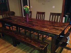 8ft vintage dark walnut James+James solid wood farmhouse table with wood bench and chairs.