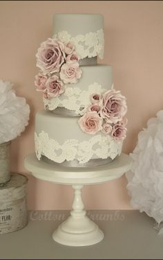 Love this cake with champagne gold coloured ribbon around the blocks instead of the grey