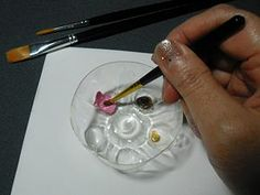 Use the bottom of a plastic bottle for a paint tray...
