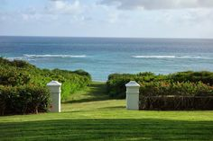 In all, the property consists of 265 acres set on a high hill.  These 2 gate posts lead to the ocean where there is a wide cut in the coral reef (where there is no surf).  This coral was used as a building material for the original home.