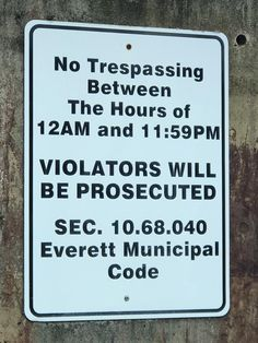 This sign says trespassing is allowed for 1 minute a day.