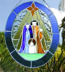 This Christmas nativity scene suncatcher is hand cut from high quality, American made, stained glass. It is constructed in the Tiffany method, meaning that each cut piece of glass is wrapped with copper foil and hand soldered to the adjoining pieces.  by StainedGlassDelight, $59.95