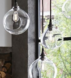 Roost Glass Bubble Lamps - Hand-blown glass bubbles make beautiful shades for these lamps that can sit flat or hang as a pendant.  Cast, copper-plated socket with chocolate brown fabric-covered cord.