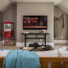 LP's Smartside panels painted in Valspar's Aspen Gray set the tone for laid-back entertaining in the media room of our All-American Cottage. | Photo: Fred Rollison | thisoldhouse.com