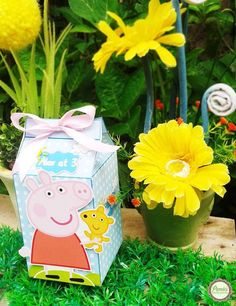 Favor boxes at a Peppa Pig birthday party! See more party ideas at CatchMyParty.com!