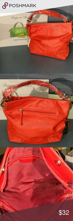 🎉NEW ITEM 🎉Joe Jones Collection Shoulder Bag Beautiful, large, red Joe Jones handbag.  Large handbag with 1 large opening separated by a large zipper pocket in the middle. A zipper pocket on the inner outside and 2 segmented pockets on the other. Measurements 16x11.5x5.  Shoulder drop 7.5. Zipper closure & 2 magnetic snap. 4 silver feet. Great buy! Joe Jones Bags Shoulder Bags