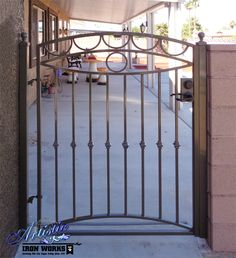 Wrought iron gate with knuckles and arching design