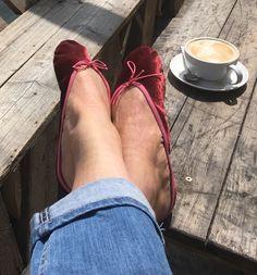Plum velvet ballet slippers in the sunshine