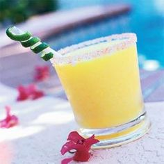 Fresh mango blends deliciously with tequila and Cointreau in this margarita recipe. For best flavor and texture, chill ingredients before preparing.