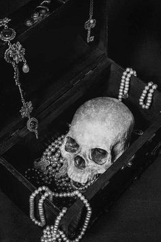 Treasure chest.  Paint a hobby store box black.  Drape jewelry and add a skull and you have a treasure chest.