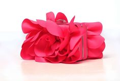 Pink floral satin clutch ($71); Wedding Shoppe, 1196 Grand Ave.; St. Paul; 651-298-1144.