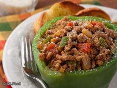 Meaty Stuffed Peppers - If you've never tried making a stuffed pepper recipe before, now's your chance. Our Meaty Stuffed Peppers are simply irresistible.