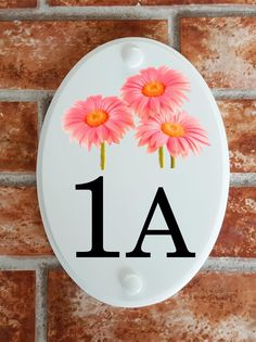 A range of pottery style house plaques feature prints of original artwork from our own sign artists. Hand cast in cultured marble these number plates are weatherproof outdoors. House Plaques, House Number Plaque, House Numbers, Hand Cast, Gerbera, Floral Motif, Original Artwork, Decorative Plates, Pottery