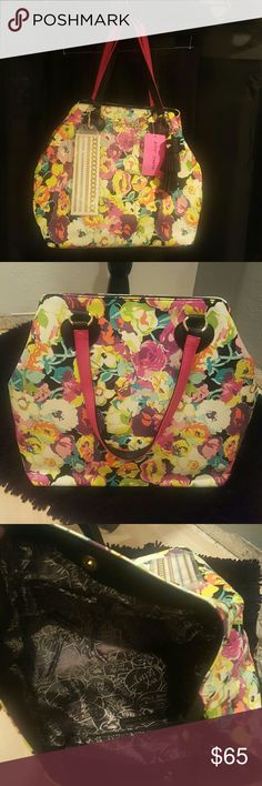 Brand New Floral Tote By Betsey Johnson LOVE this brand new Betsey Johnson bag!! It has tons of room, inside cellphone pocket, large zipper pocket, 1 inside snap closure, 1 exterior snap closure. Black suede removeable tassel at handle. Lining is black & silver. Great colors!! Size is 13in x 16in. Betsey Johnson Bags Totes