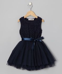 This high-quality dress has a prim bow and rosettes covering its stretchy bodice. Party-perfect and designed to pull on, it captures a little girl's idea of upscale style without skimping on comfort. Cotton / polyester / spandexMachine washImported