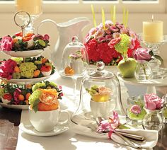 Flowers and fruit in teacups! Love the espresso cup under the glass domed dessert stand!
