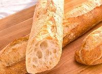 Heres a tip I learned from a chef acquaintance: The best way to reheat a store-bought baguette is to run it quickly under the tap with the water running and then put it directly into a 350 degree oven for about 10 minutes, until its crisp on the outside and warm on the inside. Ive done it this way many times...and it works! I will have to try it!