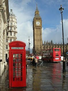 Squishing with strangers into a red box in the shadow of Big Ben?  London--If only it was a blue police box! :)