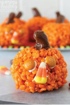 easy pumpkin krispies treats cute little pumpkin shaped rice krispies treats that can be made with candy faces for halloween or without all the way