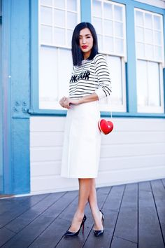 black and white stripe 'Bonjour' sweater + white midi skirt + black Louboutin heels + red heart shaped purse