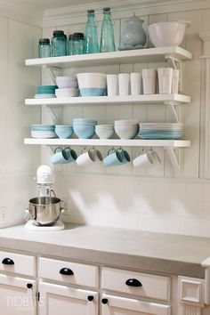 bottom shelf: white and blue  dishes from ikea Cottage Fresh Kitchen Reveal - Tidbits