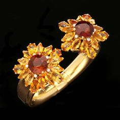 Cartier Art Deco Citrine & Diamond Cuff Bracelet, circa 1935 - With Star shaped detachable clip brooches composed of 2 circular-cut brandy coloured citrines surrounded by marquise & pear shaped cut golden citrines interspaced with diamonds. (Hancocks)