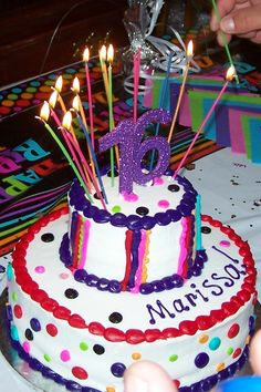 """Marissa's cake! I got the cake at WalMart, but they didn't have a purple """"16"""" to go on top. I got their standard silver """"16"""", brought it home and glued purple glitter all over it. When it was dry, I used clear spray paint to seal the glitter. It was perfect!"""