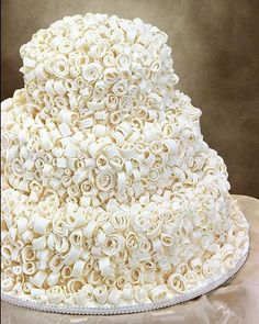 Such a unique wedding cake design. White chocolate curls stuck to buttercream Unique Wedding Cakes, Beautiful Wedding Cakes, Wedding Cake Designs, Beautiful Cakes, Amazing Cakes, Wedding Ideas, Cake Wedding, Cupcakes, Cupcake Cookies