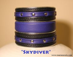 "Blue and Black Leather Cuff Wristband with Chrome by TaurusSeats ""Skydiver"" wristband is made from soft black leather with blue inlay and stripes."