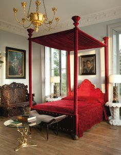 Use a bold piece, like this red canopy bed, with rich color that adds character to your bedroom #red #striking #popofcolor #elaborate #LesTroisGarcons