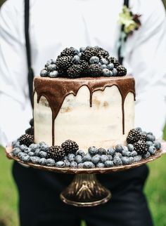 White naked wedding cake with chocolate ganache coating, gold glitter, and blackberry and blueberries topping | Moody Berry & Blue Wedding Inspiration via @Inspired by This Blog, pics by Monique Serra