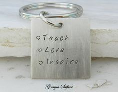 Nickel silver square Teach, Love, Inspire keychain. Teacher keychain. Graduation gift. Hand stamped keychain. Engraved keychain. by DreamCityJewels on Etsy https://www.etsy.com/listing/186752786/nickel-silver-square-teach-love-inspire