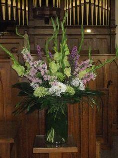 Lavender Heaven Vase-large cyclinder vase, green glads, mauve snaps, liatrus, green hydrangeas, white gerberas, white alstromeria, silk grasses & aspidistra leaves