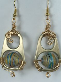 earrings from tin tabs and paper beads                                                                                                                                                      More