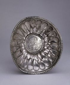 Decorated silver bowl. Late Achaemenid period with foot ring and engraved medallion added at a later date in the Parthian period, suggesting a 2nd-3rd century AD date.