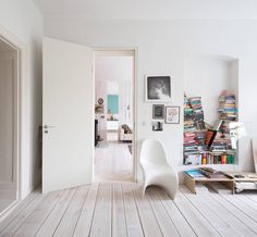 Interior:Awesome Home Design With Unique Bookcase And White Chair With White Door And Wooden Short Table And Laminated Wooden Floor Stunning. White Wooden Floor, Bibliotheque Design, Appartement Design, Living Spaces, Living Room, Scandinavian Home, Inspired Homes, House Rooms, Beautiful Interiors