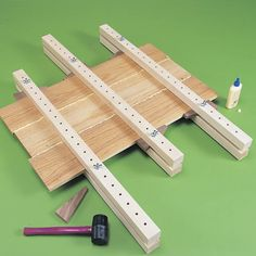 To set up the clamps for gluing a panel, slide the boards you're gluing into the clamps with-out glue. Then hammer the wedges in. #woodworkingprojects #woodworkingtips