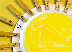 1) Color the back side of a paper plate yellow. Color the tops of the clothespins yellow as well. 2) Write all 26 letters (lowercase) on individual clothespins. 3) Have your child clip the clothespins in ABC order around the paper plate to make a sun.
