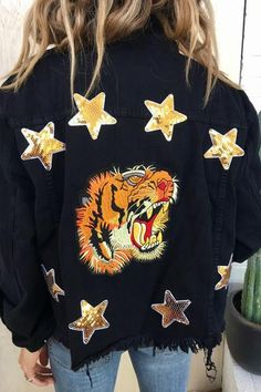 You're gonna hear me ROAR! Edgy dark washed denim jacket featuring a large tiger embroidery on the back. Constructed with a collared neck, button down closure a