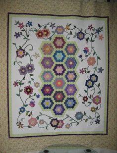 1 More Stitch: Grandmother's Flower Garden. A lovely arrangement.