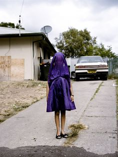 Award winning world press photo of aboriginal girl Laurinda, a young Kamilaroi girl, plays with her dress as she waits for the bus that will take her to Sunday school. Many disadvantaged communities in Australia face entrenched poverty, racism, trans-generational trauma, violence, addiction, and a range of other barriers to health and wellbeing.  Credits to Photographer: Raphaela Rosella #worldpressphoto #Australia