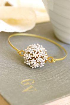 Queen Ann's Lace. Vintage white enamel flower and rhinestone bracelet.Tiedupmemories. $32.00, via Etsy.